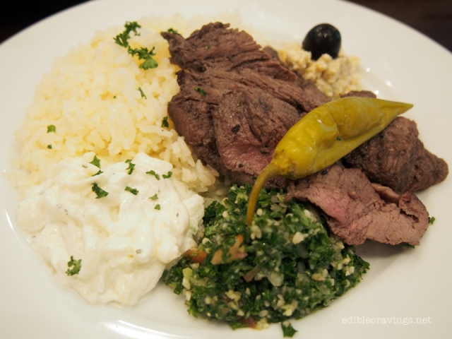 Tzatziki, Tabbouleh, Grilled Beef, and Baba Ganoush with Buttered Rice